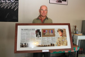Dunmarra Roadhouse owner Gary Frost is presented with a Borella VC Memorial Board