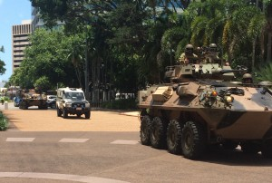 A convoy of police and Defence Force vehicles escort the Victoria Cross to Parliament House.